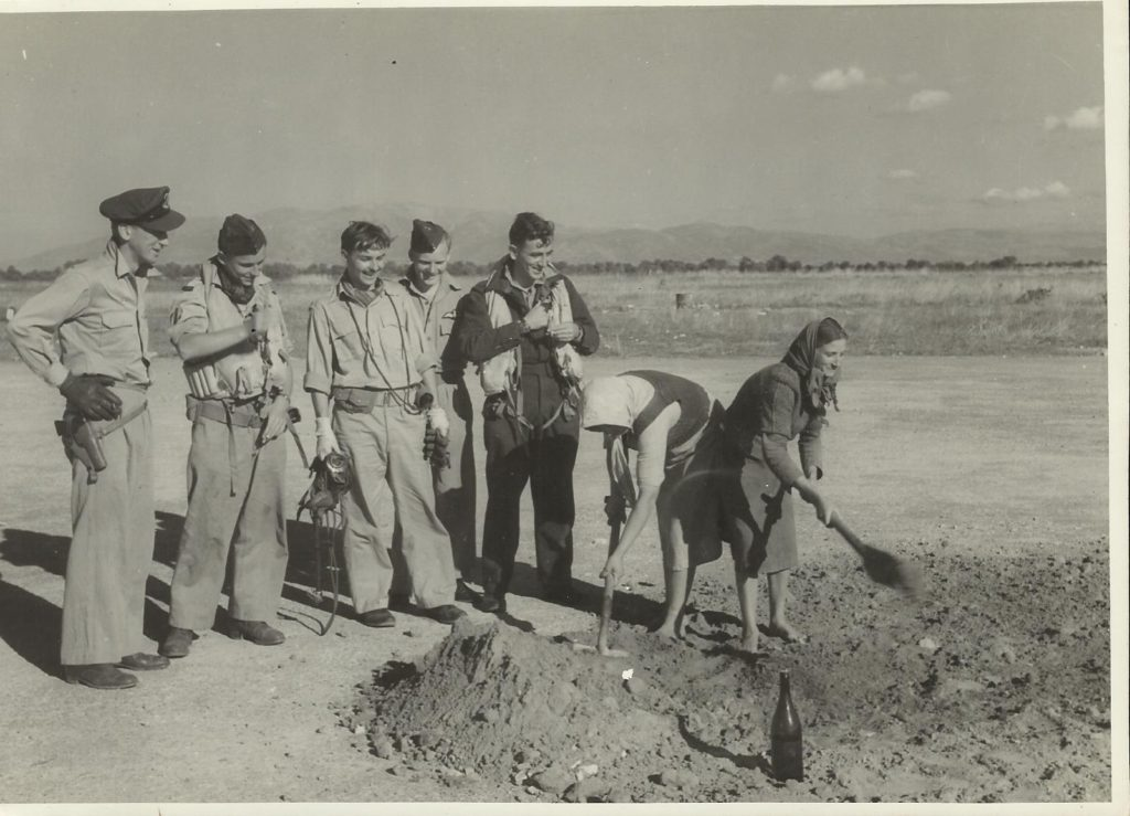 john wall-2nd left%2c Araxos greece%2c local women mend runway 1944 4